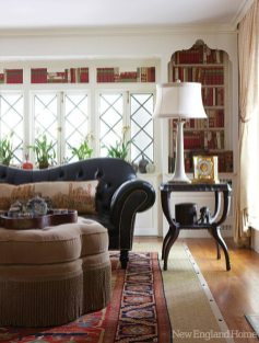 In Richard Ott's stylish yet relaxed living room, layers of texture—an oriental rug atop sisal, for example—and rich red tones create a warm space.