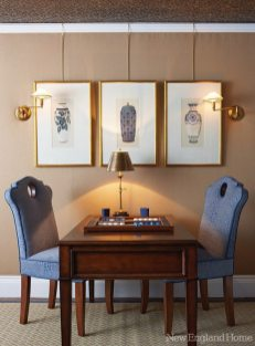An upstairs room became a cozy sitting room. Sharon McCormick brought elegance to the space with new millwork, linen wallcovering and a ceiling painted to look like gilded leather.