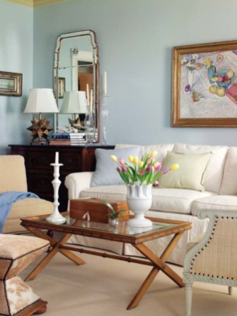 Pale blue walls make a serene backdrop for warm, neutral furnishings in the living room.
