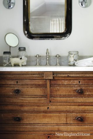 An antique marble-top chest stands in for a vanity in the master bath.