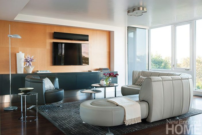 AFTER: Modern, neutral furnishings don't compete with the apartment's stunning view of the Charles River.