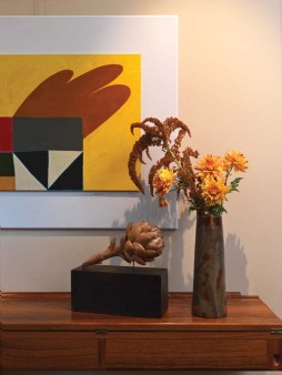 An artichoke by sculptor Fumio Yoshimura and a painting by Ambrose Phillphister grace a spot in the foyer