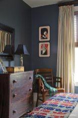 The tiny powder room features a romantic Sanderson wallpaper.