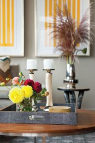 Touches of bright color in art and accessories pop against the neutral walls and furniture.