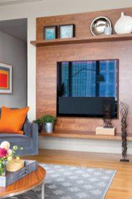 A walnut surround gives the TV a fireplace-like feel.