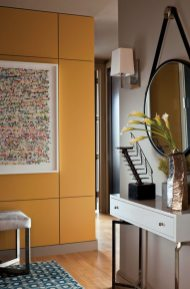 New paneling painted a warm gold gives the small foyer dramatic impact.