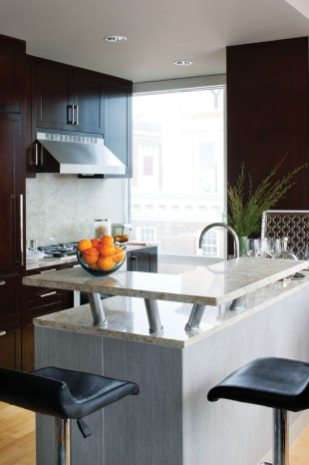The countertop's raised slab was added for more surface space and informal dining.