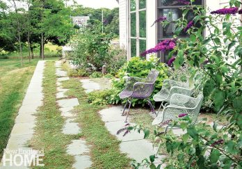 Keith LeBlanc's program for a West Yarmouth property keeps things natural; near the house, a buddleia brings color to a sitting area.