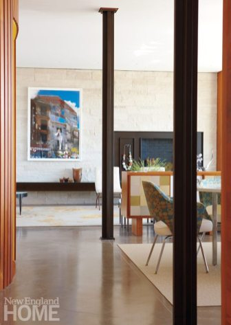The dining and living rooms are separated by a low-lying, built-in buffet, which enables the fireplace to be visible from the dining table.
