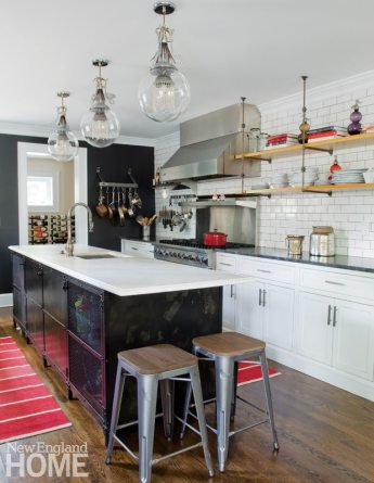 Chef's kitchen with metal cabinet island