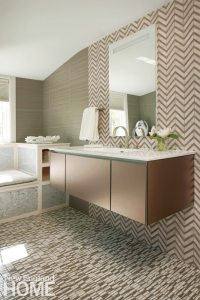 Contemporary bathroom with floating vanity designed by Heidi Pribell.