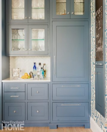 Bar area with blue cabinetry