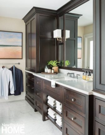 A coffee-colored stain enriches the mahogany vanity and armoires in the husband's bath.