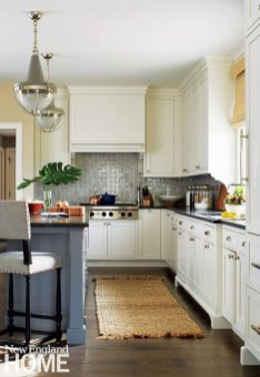 Updated traditional classic Shaker-style cabinets with honed black granite countertops