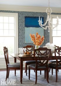 "The English paisley wallpaper in the dining room is a perfect contrast to the formal, beaded Italian-glass chandelier. ""Even when it's not turned on,"" says Hirsh, ""it still looks as if it's glowing."""