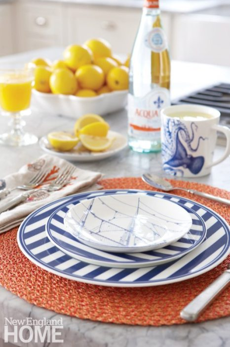 Blue and white place setting with Caskata dinnerware