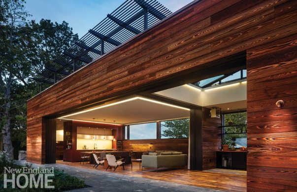 Rhode Island architect Michele Foster and Kistler & Knapp Builders collaborated on this spectacular pool house in Newport, R.I., which boasts a sliding glass wall that opens the space almost entirely to the outdoors.