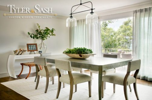 Sophisticated dining room with pleated drapes