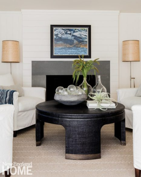 Lisa Tharp Seating Area. Linen Slip Covered Chairs and Black Coffee Table