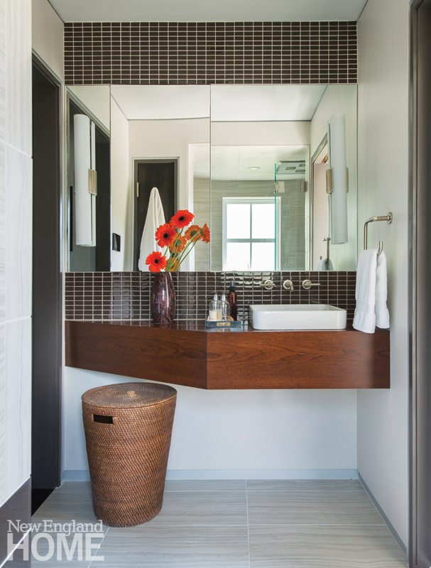 The master bath's rainfall chromatherapy shower is reflected in the mosaic-framed mirror above the sleek vanity.