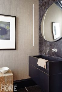 Contemporary Boston town home powder room with black corian sink