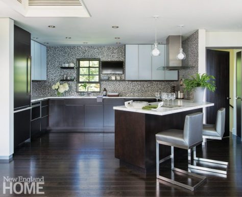 A glass and metal penny-round mosaic tile forms the kitchen's backsplash.