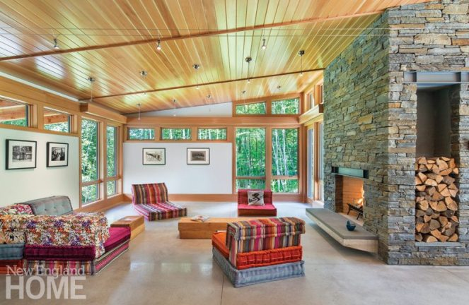A massive fieldstone fireplace gives the open great room a warm feel.