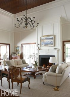 Architect Patrick Ahearn borrowed space from the second floor to vault the great room ceiling, and added French doors to enhance the indoor/outdoor flow. Natural fibers in neutral colors help temper the formality of the owners' English antiques.
