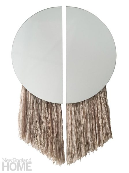 The Apollo mirror, named for the Greek God of the Sun, comprises two half-circle mirrors joined by negative space and partnered with hand-spun, hand-painted silk fiber.