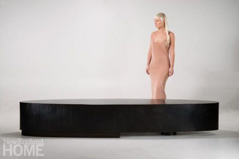 The large-scale blackened steel Ellipse table.