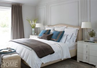 Three-drawer side tables from Bungalow 5 flank the master bedroom's cozy upholstered bed.