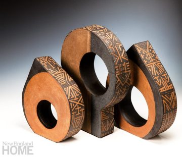 I Am Africa, brown stoneware and black slip, 11″H × 9″W × 4″D, 16″H × 12″W × 4″D, and 13″H × 11″W × 4″