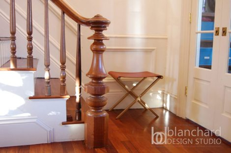 The newel post, railings, and balustrades of this staircase in a historic Boston home were painstakingly restored. Worn treads were completely replaced with lustrous walnut planks.
