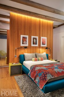 Contemporary master bedroom with wood floating wall