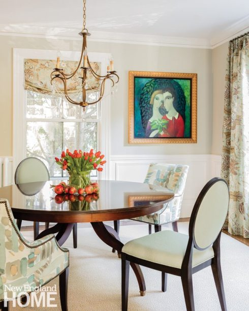 In the dining room, Benedict paired a round table with captain's chairs, and chose an elegant chandelier with a touch of crystal to lend a hint of formality without being too showy.