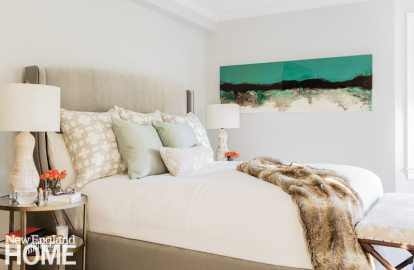 A cozy, upholstered bed from Bernhardt is the centerpiece of the master bedroom.