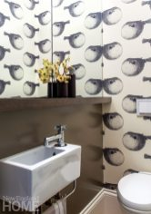 Small powder room with Abnormals Anonymous wallpaper