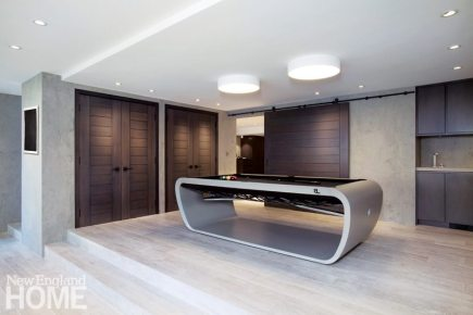 Contemporary play room with custom billiard table
