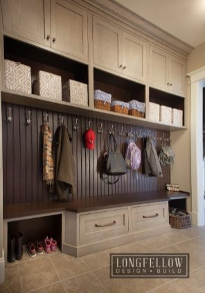This mudroom is command-central with a smart mix of open shelving, cabinetry and cubbies.