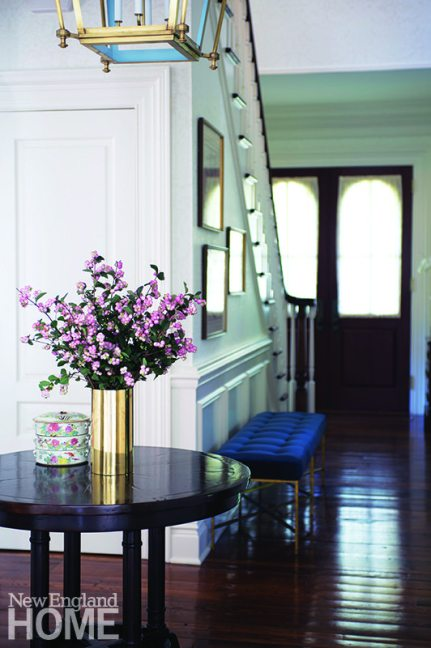 The goal was to downplay the home's neo-Victorian roots in favor of a more transitional aesthetic, a tone Caccoma sets right from the foyer.