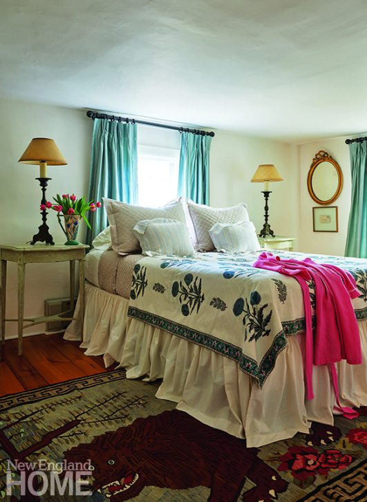 Guest bedroom with quilt and Afghani rug