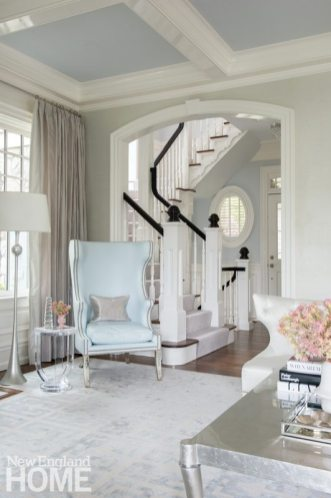 A wing back chair covered in pale blue fabric
