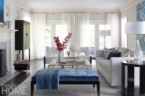 Elegant white living room with blue bench