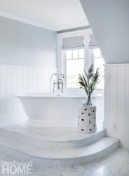 A marble mosaic floor gives the master bath a luxurious ambience.