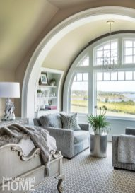For continuity, interior designer Sharon Cameron Lawn carries the neutral palette into the master bedroom. Contrasting with the upholstered furnishings, throws, and pillows, a metallic faux bois garden stool adds an interesting note of texture.