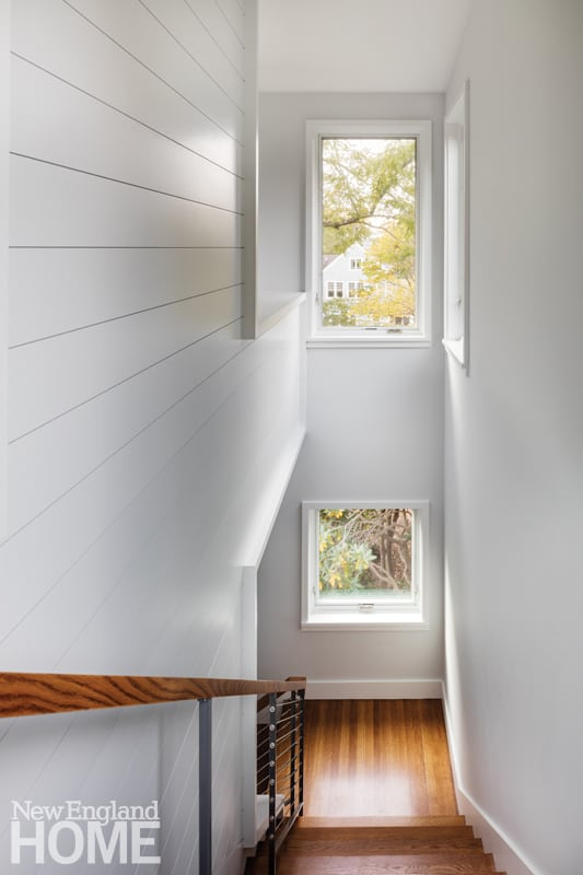 The stairwell from the family room to the ground floor also incorporates shiplap paneling.