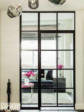 Subbing in a glass door to the den enabled natural light to flow to the foyer.