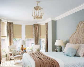 Seafoam-hued grasscloth wraps the bedroom in a soothing embrace.