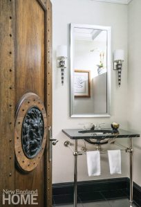 Powder room with beaded white wallpaper