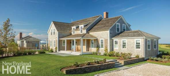 The traditional clapboard home includes a welcoming front porch and a driveway of crushed white clamshell and native pea stone.